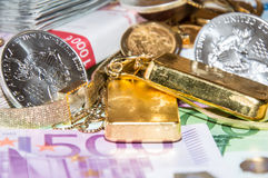 Euro Bills, Gold and Silver Stock Photos