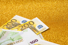 200 euro bills on golden sparkling background. A lot of money, luxury stock images