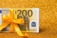 200 euro bills on golden sparkling background. A lot of money, luxury Royalty Free Stock Photos