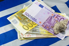 Euro bills on the Greek flag with the shell on top Royalty Free Stock Photography