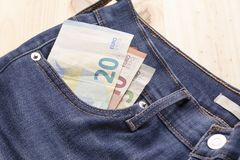 Euro bills in jeans pocket royalty free stock photo