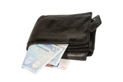 Euro bills in a leather wallet. Euro bills in an old black leather wallet (isolated on white Royalty Free Stock Photos