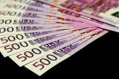 500 euro bills isolated on black. Lot of 500 euro bills isolated on black background Royalty Free Stock Photography