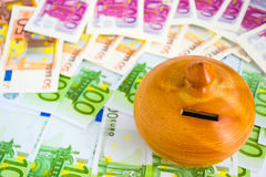 Euro bills and moneybox Royalty Free Stock Photo