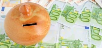 Euro bills and moneybox Royalty Free Stock Photos