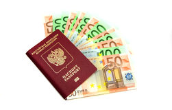 Euro bills in the passport on white Royalty Free Stock Photo