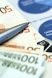 Euro  bills and pen Stock Photo