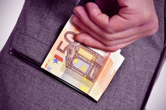 Euro bills in the pocket Stock Images