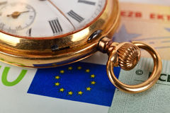 Euro bills and pocket watch Royalty Free Stock Photography