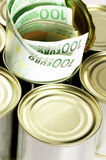 Euro bills on a tin can. Over white background Stock Photos