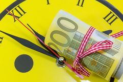 Euro bills on top of the clock Stock Photography