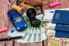 Euro bills for a travel, car, maps, passport, and other stuff for adventure. On the table royalty free stock image