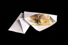 Euro bills in white envelope Stock Images