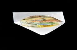 Euro bills in white envelope Stock Photos