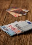 Euro bills on wooden board with credit cards in background Stock Photos