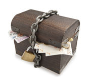 Euro bills and wooden trunk. Stock Photo