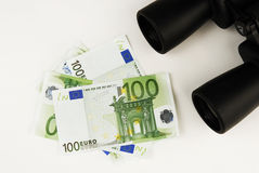 Euro and binoculars Royalty Free Stock Images