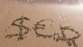 Euro, Bitcoin and Dollar signs written in the sea sand. Waves washed away the inscription. Euro, Bitcoin and Dollar signs written in the sea sand. Waves washed stock footage