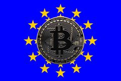Euro Bitcoin. A physical bitcoin overlaid on the flag of the European Union Stock Photo