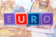 Euro in blocks on money Stock Image