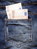 euro in the blue jeans pocket Stock Images