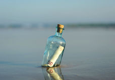 50 euro in a bottle on the beach. Bottle found on the beach with a 50 euro bill inside Royalty Free Stock Photo