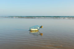 50 euro in a bottle on the beach Royalty Free Stock Photos