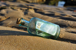 100 euro in a bottle on the sand Stock Images