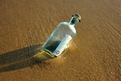 50 euro in a bottle on the shore of the sea. Bottle found on the sand of the beach with a 50 euro bill inside Royalty Free Stock Image