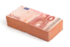 Euro brick. Brick with an Euro bank note imprint Stock Image