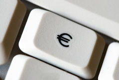 Euro button. Desktop computer keyboard   with dollar sign - on blue light Royalty Free Stock Photo