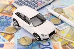 Euro Car Finance. A luxury car finance metaphor in Euro money stock photos