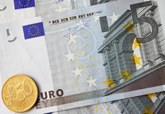 Euro Cash. Five euro banknotes and fifty eurocents coin Stock Images