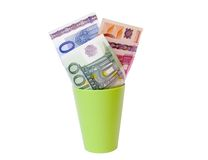 Euro cash. Euro banknotes in a green cup Royalty Free Stock Photo