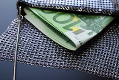 Euro Cash in Fancy Evening Bag. Two hundred Euro bills in a fancy evening bag, horizontal view Royalty Free Stock Photography