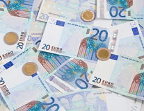20 Euro cash. 20 Euro papers background with two euro coins stock photography