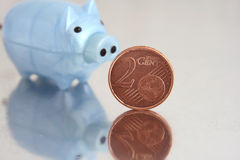 Euro cent. Close up of piggy bank on Euro cent Royalty Free Stock Images