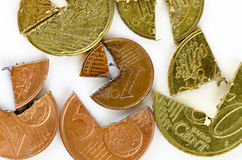 Euro-Cent coins cut into pieces. Euro-Cent coins cut in different pieces Stock Images