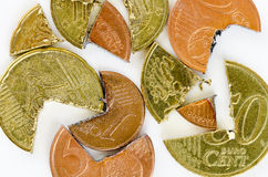 Euro-Cent coins cut into pieces #2. Euro-Cent coins cut in different pieces Royalty Free Stock Photos