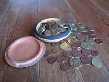 Euro Cent in pottery money box on Wood Stock Images