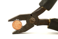 Euro cent tightly squeezed in pliers Royalty Free Stock Photography