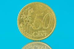 Euro cent vijftig op blauwe achtergrond Stock Foto's