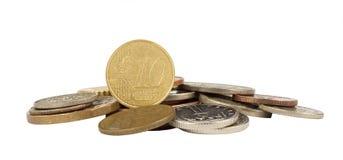Euro centmuntstuk op wit met andere muntstukken Stock Foto's