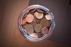 Euro cents. Glass jar full of euro cents stock photography