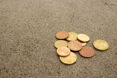 Euro cents on the cement road. Money euro cents in coins on the cement road with texture stock photo