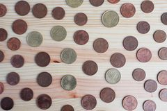 Euro cents on wooden background royalty free stock photography
