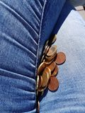 Euro cents between jeans. Money, rich, legs royalty free stock image