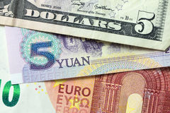 Euro, China Yuan and US dollar banknotes. Forming background royalty free stock photos