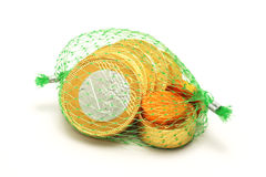 Euro chocolate wrapped in metal foil and packaged in a green grid Royalty Free Stock Photography