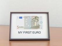 Euro cinco en un marco Fotografía de archivo libre de regalías